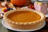 15195172-a-pumpkin-pie-on-a-thanksgiving-dinner-table